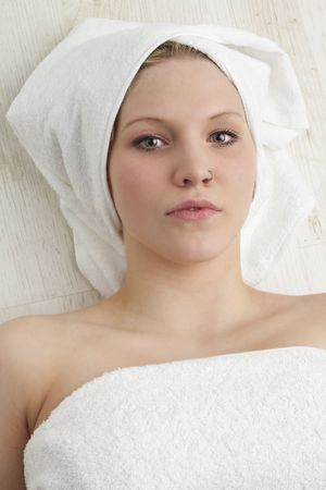 woman in towels during a spa treatment photo