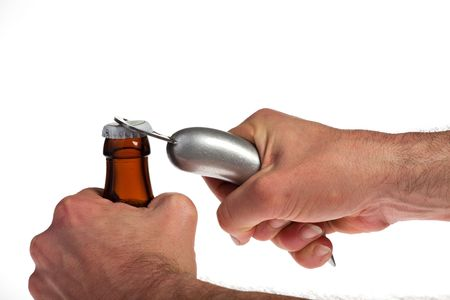 Hands opening a beer bottle on a white background Stock Photo
