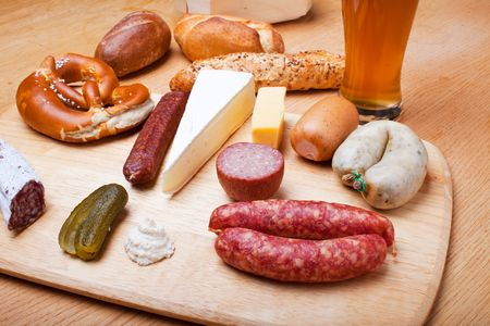 sausages, bread and a wheat beer on oak Stock Photo - 6182246