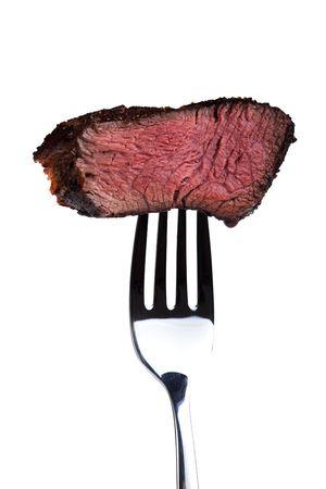 bistecche: pezzo di una bistecca alla griglia su una forcella