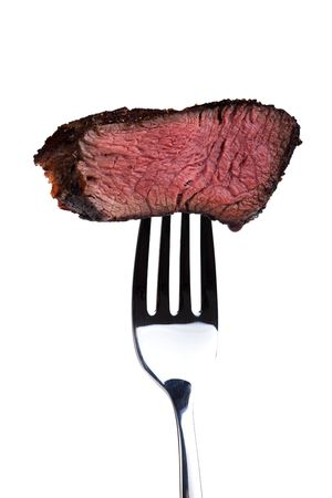 sirloin steak: piece of a grilled steak on a fork