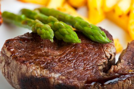 grilled steak with green asparagus photo