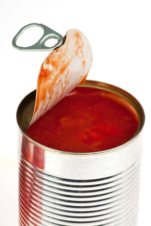 canned raw food and tomatoes isolated on white photo