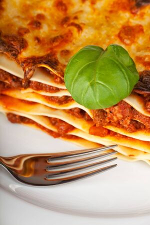 lasagna noodle dish on a white plate Stock Photo