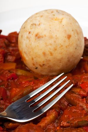 hungarian goulash and bread dumpling with a fork photo