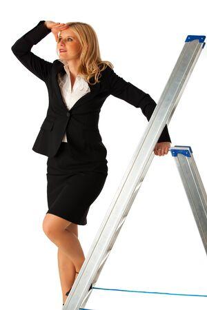 business woman climbing a ladder photo
