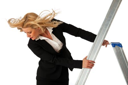 business woman climbing a ladder photo