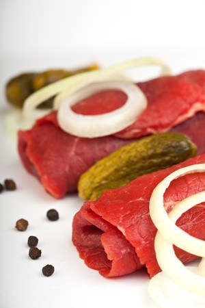rolled raw veal cutlets and assorted ingredients photo