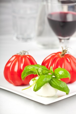 tomatoes, mozzarella, basil and red wine Stock Photo - 7008545