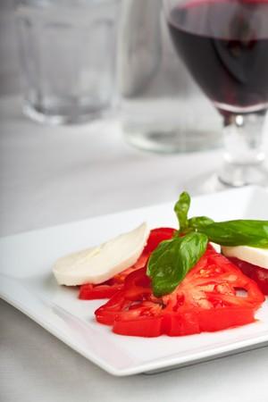 tomatoes, mozzarella, basil and red wine Stock Photo - 7340071