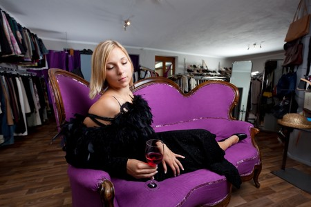 young woman sitting in a boutique photo
