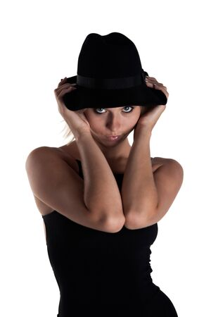 bronzy: young woman in a black dress and a hat