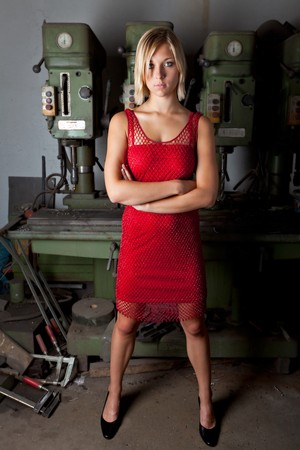 blonde in a red dress in a garage workshop photo