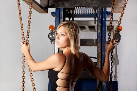 young woman in a black dress and a fork lifter Stock Photo - 7721087