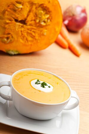 pumpkin soup in a white bowl
