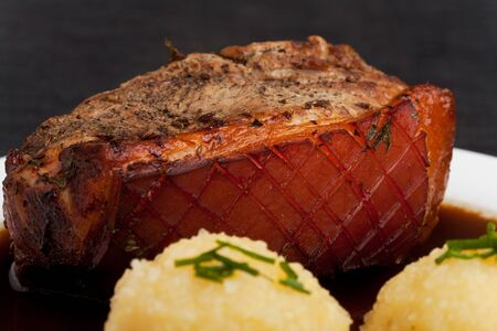 bavarian roast pork dish with potato dumplings photo