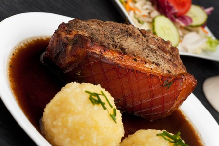 bavarian roast pork dish with potato dumplings photo