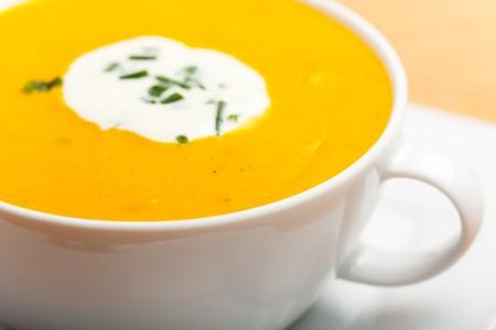 pumpkin soup in a white bowl photo