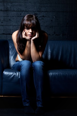 woman on a leather couch in despair photo