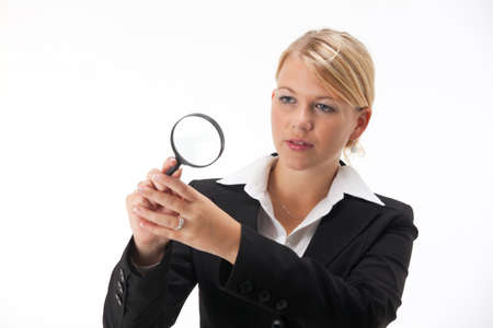 business woman with a magnifier Stock Photo - 8053849