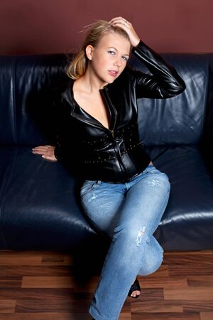 sensual woman in a leather jacket photo
