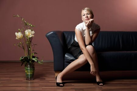 blonde woman on a couch  Stock Photo - 16335460