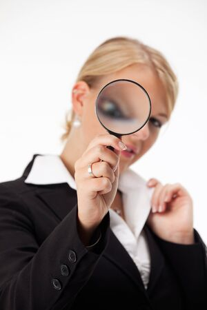 business woman looking through a magnifier  photo