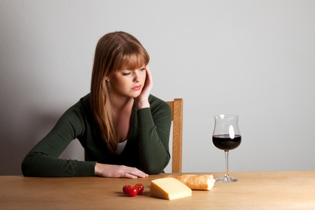 young woman and a glass of wine photo