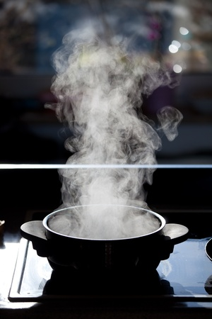 boiling pot: steam rising off a boiling pot