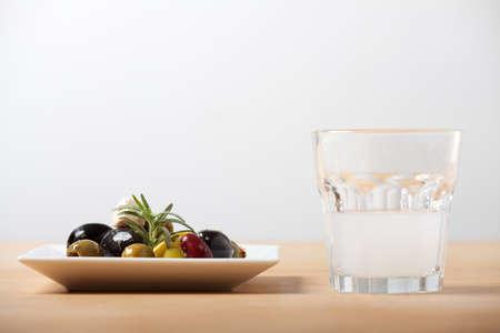 closeup of mixed antipasti with ouzo photo