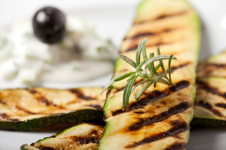grilled zucchini with a rosemary leaf 免版税图像 - 8819021