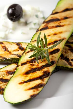 grilled zucchini with a rosemary leaf photo