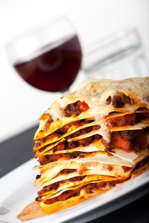 closeup of lasagna with red wine Standard-Bild