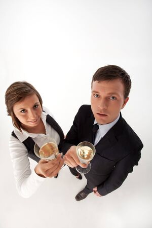 business couple celebrating with champagne photo