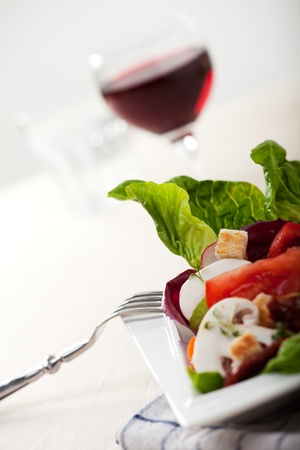 wine and food: detail of fresh mixed salad