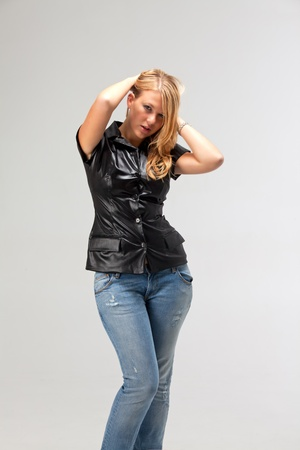 blonde woman in a leather vest and jeans Stock Photo - 16335461