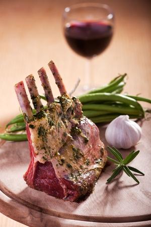 closeup of raw lamb chops photo