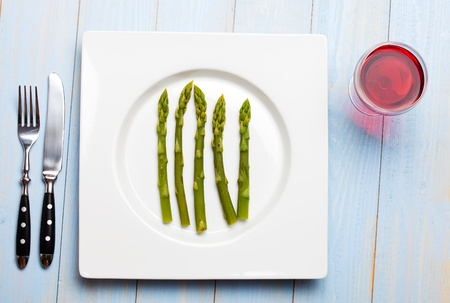 green asparagus on a white plate Stock Photo - 9515788