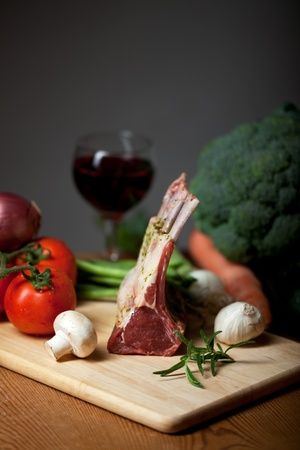 raw lamb meat and assorted vegetables photo