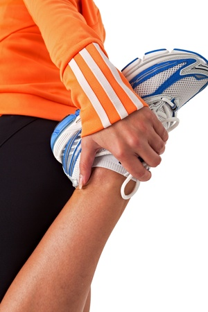 sporty young woman stretching her leg photo