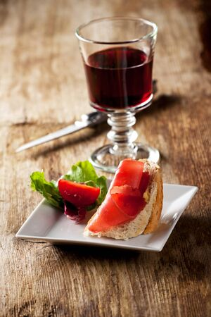 jambon: closeup of a ham sandwich and red wine