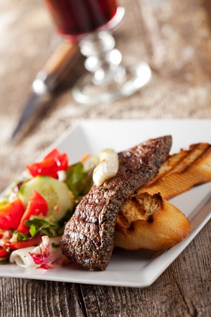 detail of a steak with salad photo