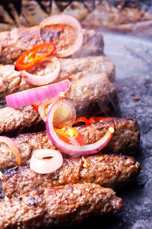 cevapcici minced meat rolls in a pan Stock Photo - 10307364