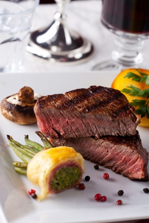 steak with grilled potato on a plate photo