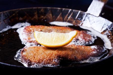 wiener schnitzel in an iron pan  photo