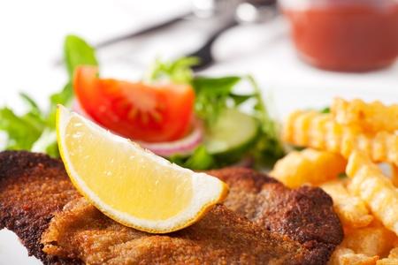 wiener schnitzel and french fries  Standard-Bild