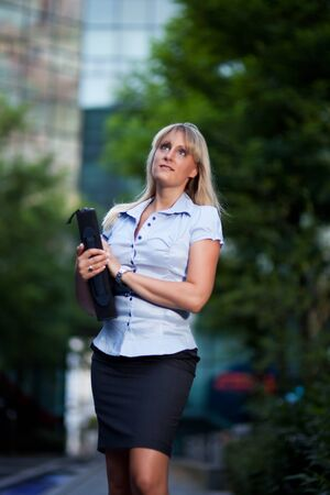 business woman sitting outdoors photo