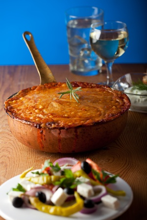 baked moussaka dish on a wooden board Stock Photo - 10729057