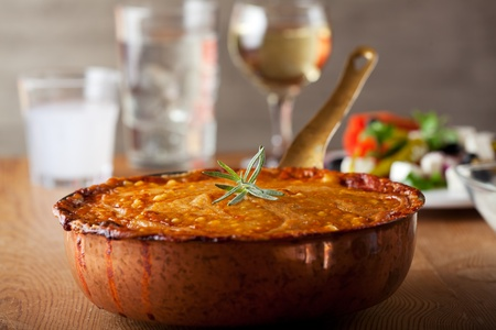 baked moussaka dish on a wooden board Stock Photo