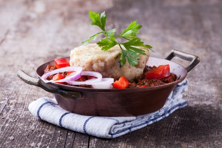 goulash with dumpling on a wooden plank Stock Photo - 10763786